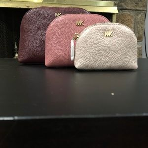 Michael Kors 3-in-1 cosmetic bags. New w/o tags.